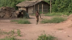Baka people vilage life boy playing with ring Stock Footage