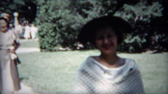 1954: Family enjoying a day walking around in the public park. Stock Footage