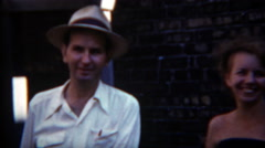 1954: Brother and sister city alley street shadow shenanigans. Stock Footage