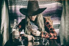 Cowgirl Gunslinger Poker Cards Stock Photos