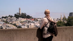 Woman Overlooks San Francisco Coit Tower Stock Footage
