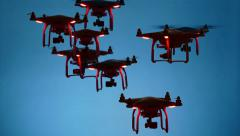 Dark Swarm of Drones on Blue Background Stock Footage