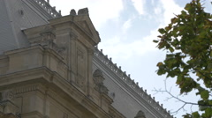 Sculptural details on the top of a building in Bucharest Stock Footage