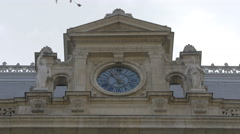 Old clock on the Bucharest Court of Appeal with statues in Bucharest Stock Footage