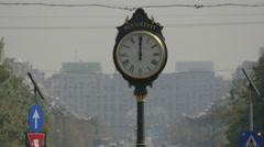 Vintage street clock on Union Boulevard in Bucharest Stock Footage