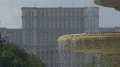 The Palace of Parliament seen behind a fountain in Bucharest Stock Footage
