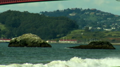 Golden Gate Bridge Zoom Out from Rocks - stock footage