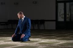Businessman Muslim Praying In Mosque - stock photo