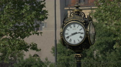 Vintage street clock in Unirii Square, Bucharest Stock Footage