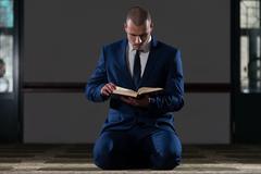 Muslim Businessman Reading Holy Islamic Book Koran Stock Photos