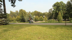 Happy young mother with her son in the summer park - stock footage