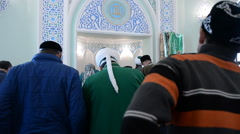 The faithful Muslims in a mosque. Stock Footage