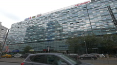Modern office building on Nicolae Titulescu Street in Bucharest Stock Footage