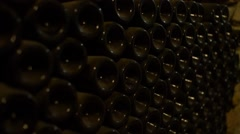 Old wine bottles nestled in dust in the winery cellar Stock Footage