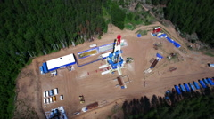 Aerial view of oil gas drilling tower in forest Stock Footage