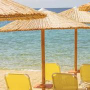 Sunshade and Chairs on the Sandy Tropical Beach, Summer travel destination Stock Photos