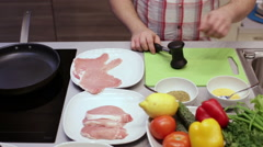 Cook pork beats hammer in the kitchen Stock Footage