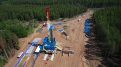 Oil gas drilling tower in forest Stock Footage