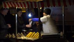 Street vendor selling corn and chestnut at night in Istanbul Turkey (Editorial) Stock Footage