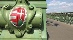 Budapest Freedom bridge slider shot - Coat of arms of Hungary Stock Footage