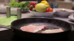 Roasting meat on a frying pan Stock Footage