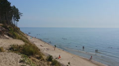 Sandy beach with people, Baltic sea Stock Footage
