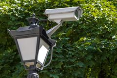 Camera cctv on top of street lantern - stock photo