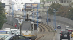 Cars and trams traveling on Basarab Overpass in Bucharest Stock Footage