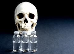 Skull and medical vials Stock Photos