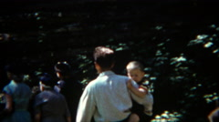 Stock Video Footage of 1954: Family exploring Wisconsin Dells geological formation park.