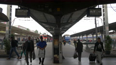 People waiting and walking on the train station platform in Bucharest Stock Footage