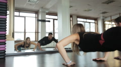 Beautiful girl athlete fitness instructor, is pushed off the floor with his Stock Footage