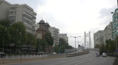 Apartment buildings and church near Basarab Overpass in Bucharest - stock footage