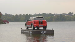 Mini Cooper car floating on a wooden platform on Lake Herăstrău, Bucharest Stock Footage