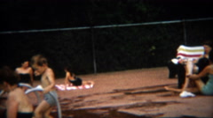 1954: Aunt taking care of all the kids swimming horseplay in the pool. - stock footage