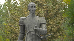 Man statue with sword in Bucharest Stock Footage