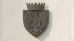 The Bucharest coat of arms on a building in Bucharest Stock Footage