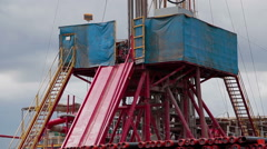 Oil Drilling rig A vertical pan Stock Footage