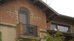 Brick house with balcony in Bucharest Stock Footage