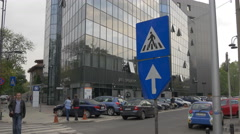 Pedestrian crossing sign near a tall glass building in Bucharest Stock Footage