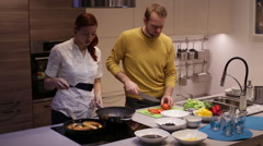 Family in the kitchen preparing dinner - stock footage