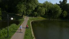 Rollerskating at Moczydło Park in Warsaw by HeliDog_Aerials Stock Footage