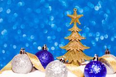 Golden Christmas tree on glitter blue background - stock photo