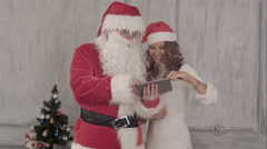 Loughing Santa and beautiful woman use tablet Stock Footage