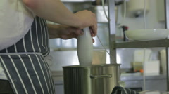 Chef using hand blender in kitchen Stock Footage