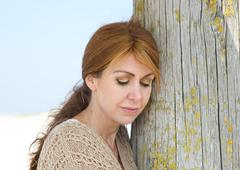 Close up portrait of a middle aged woman looking sad - stock photo