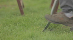 Man using a spade to dig grass - stock footage