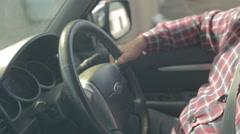 Man in car driving using steering wheel Stock Footage