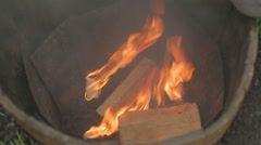 Man starting fire in a fire pit - stock footage