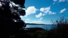 Time lapse clouds travel over a coastal lagoon, Oregon - Time Lapse 2041 HD, 4K Stock Footage